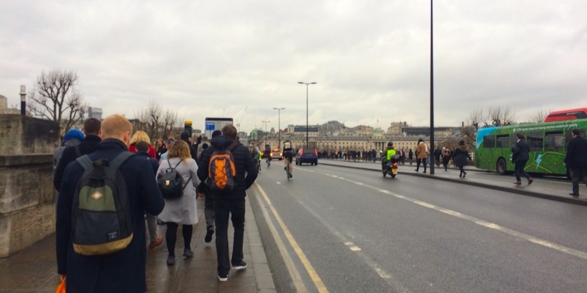Tube strike London walkers on bridge