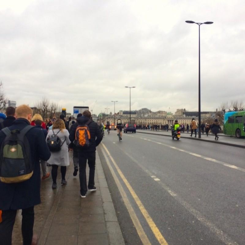 Tube strike London walkers on bridge